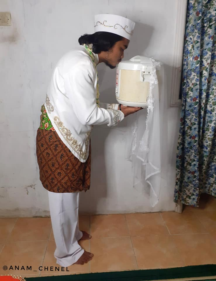 Indonesian Man Kissing A Rice Cooker